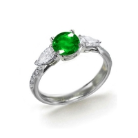 green emerald engagement rings