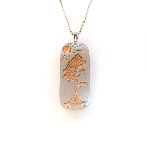 Copper and silver mokume pendant