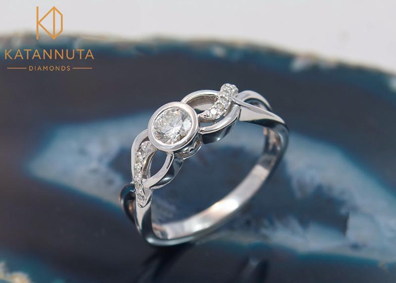 Tube set diamond engagement ring