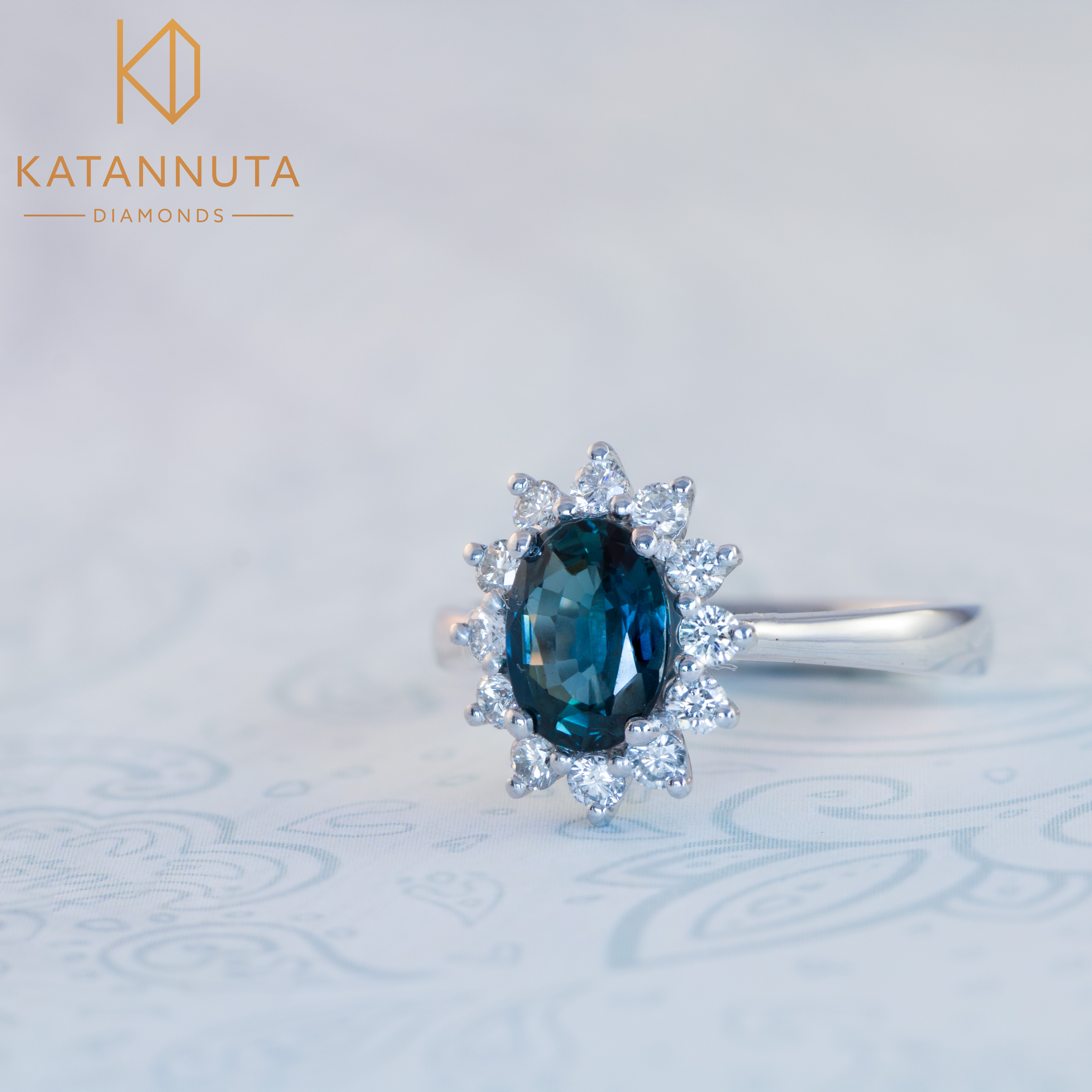 Oval peacock sapphire engagement ring