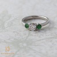 3-stone diamond engagement ring with tsavorite