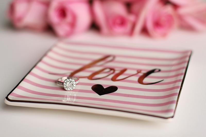 Diamond engagement ring on plate