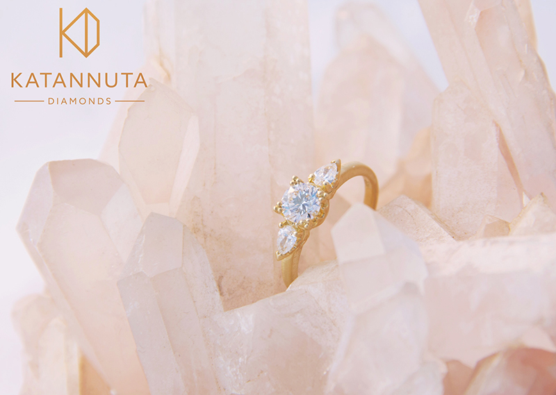Round and pear cut diamond ring