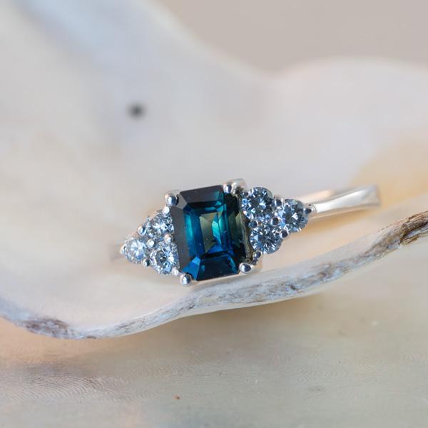 Emerald cut peacock sapphire ring