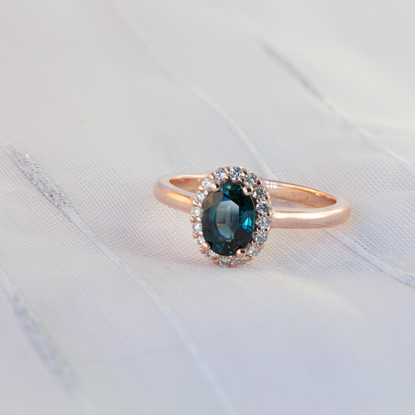 Oval halo peacock sapphire ring