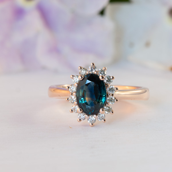 Cluster peacock sapphire engagement ring