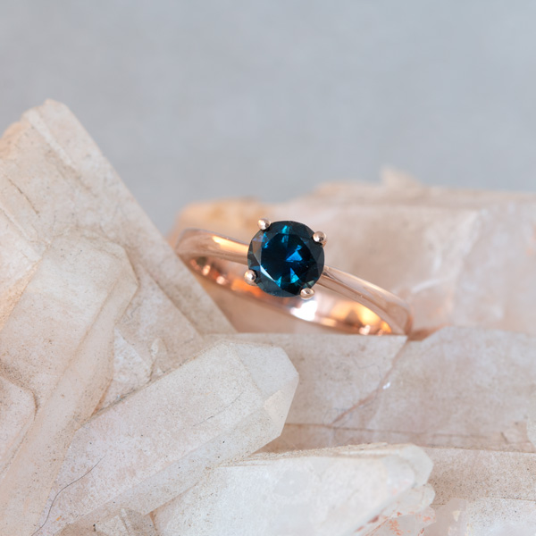 Round peacock sapphire solitaire ring